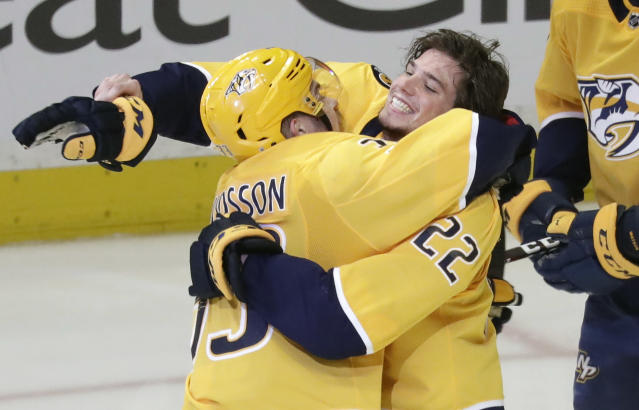Nashville Predators left wing Kevin Fiala (22), of Switzerland, celebrates with Viktor Arvidsson, of Sweden, after Fiala scored the winning goal against the Winnipeg Jets during the second overtime in Game 2 of an NHL hockey second-round playoff series Sunday, April 29, 2018, in Nashville, Tenn. The Predators won 5-4 to tie the series 1-1. (AP Photo/Mark Humphrey)