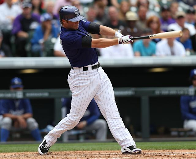 Colorado Rockies' Josh Rutledge follows the flight of his RBI-single against the Los Angeles Dodgers in the fifth inning of a baseball game in Denver on Saturday, June 7, 2014. (AP Photo/David Zalubowski)