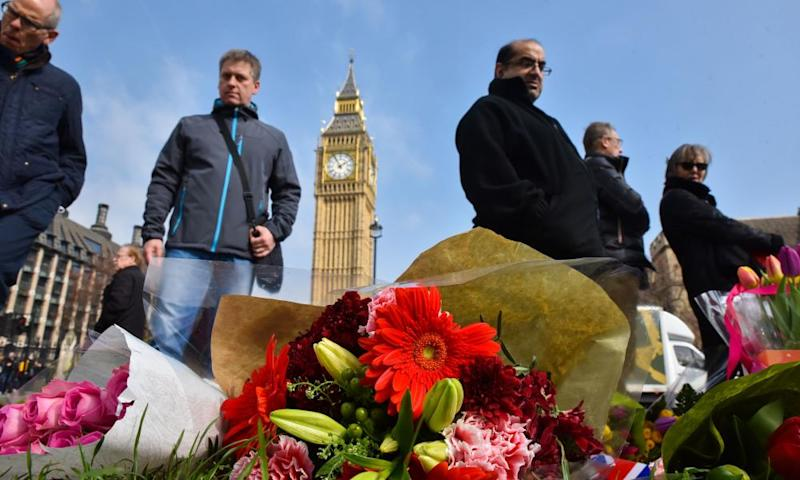 Flowers and tributes left outside Parliament after the Westminster terror attack