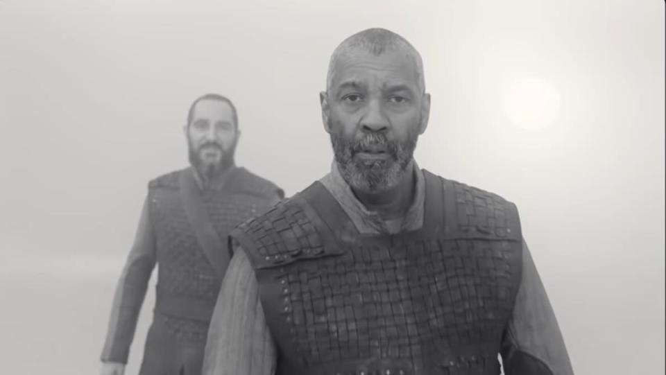 Denzel Washington as Lord Macbeth in The Tragedy of Macbeth stares at camera in black and white still