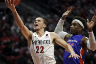 San Diego State guard Malachi Flynn, left, shoots as Boise State forward Abu Kigab defends during the second half of an NCAA college basketball game Saturday, Jan. 11, 2020, in San Diego. (AP Photo/Gregory Bull)