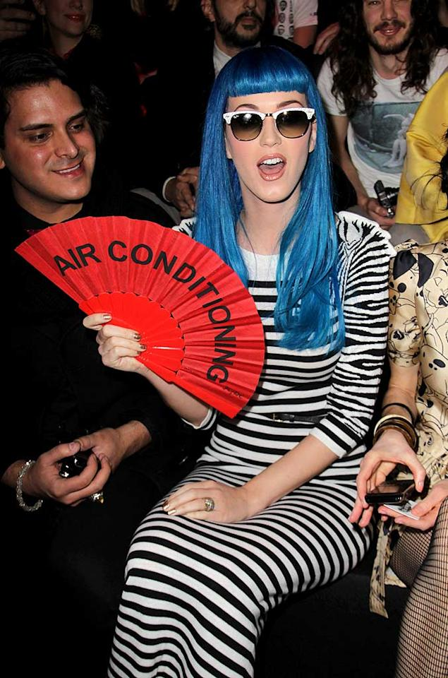 """Over in Paris, Katy Perry -- who plays Smurfette in the upcoming 'Smurfs"""" film -- showed her loyalty to the blue crew when she donned a bright blue wig for the Jean-Charles de Castelbajac fall 2011 show at Paris Fashion Week on Tuesday. Do you think her look is hot ... or not? Tony Barson/<a href=""""http://www.wireimage.com"""" target=""""new"""">WireImage.com</a> - March 8, 2011"""