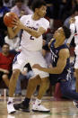 Connecticut's James Bouknight, left, fights off the defense of Xavier's Bryce Moore in the first half of an NCAA college basketball game during the Charleston Classic Friday, Nov. 22, 2019, in Charleston, SC. (AP Photo/Mic Smith)