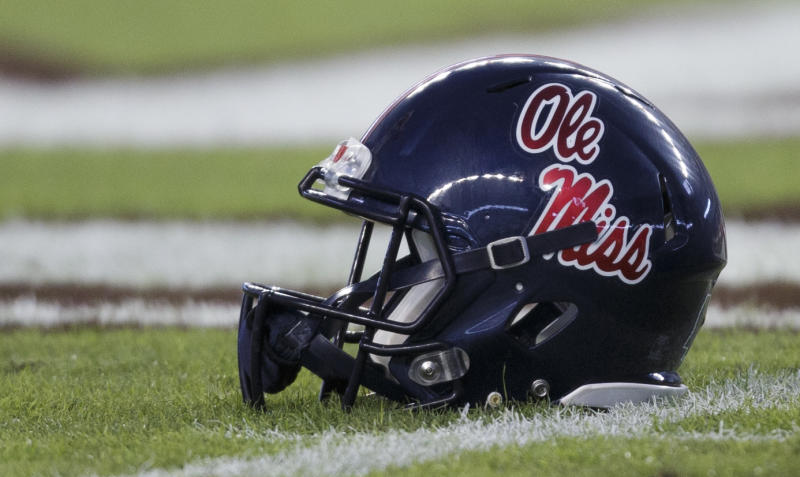 An Ole Miss helmet sits alone on the field.
