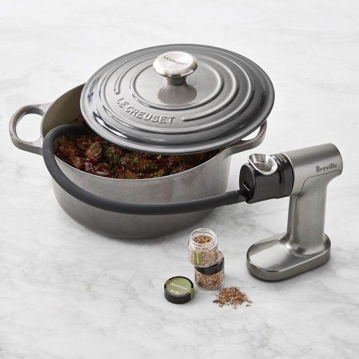 """<p>williams-sonoma.com</p><p><strong>$99.95</strong></p><p><a href=""""https://go.redirectingat.com?id=74968X1596630&url=https%3A%2F%2Fwww.williams-sonoma.com%2Fproducts%2Fbreville-smoking-gun&sref=https%3A%2F%2Fwww.thepioneerwoman.com%2Fholidays-celebrations%2Fgifts%2Fg36188027%2Fbest-fathers-day-gifts%2F"""" rel=""""nofollow noopener"""" target=""""_blank"""" data-ylk=""""slk:Shop Now"""" class=""""link rapid-noclick-resp"""">Shop Now</a></p><p>Okay, this is <em>way</em> cool. He'll be able to use this smoking gun to infuse both food and drink with the scent and taste of smoke. </p>"""