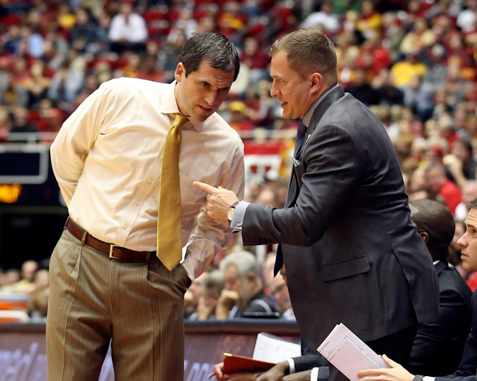Iowa State coach Steve Prohm and assistant T.J. Otzelberger visit during a timeout against the Buffalo Bulls on Dec. 7, 2015.