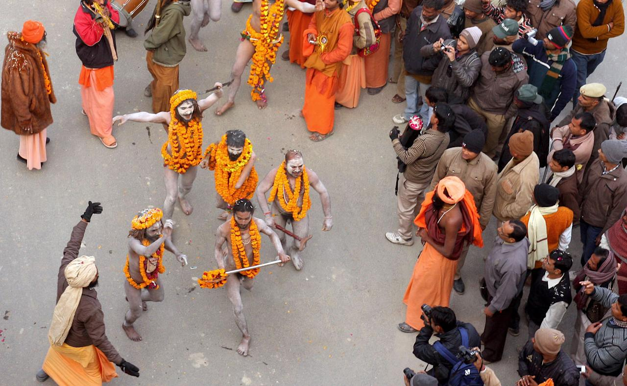 "Indian Naga Sadhus - holy men - of Shri Panchayati Anand Akhara participate in a religious procession as the first ""royal entry"" for the Kumbh Mela at Sangam in Allahabad on January 6, 2013. The Kumbh Mela, which is scheduled to take place in the northern Indian city in January and February 2013, is the world's largest gathering of people for a religious purpose and millions of people gather for this auspicious occasion. AFP PHOTO/Sanjay KANOJIA"