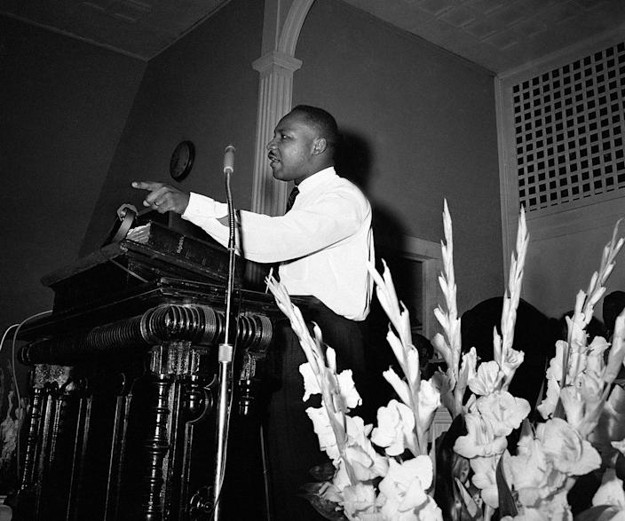 <p>Integration leader Martin Luther King Jr., Atlanta minister, speaking to a church filled to overflowing, in Albany, Georgia on July 22, 1962, about the legal fights ahead. King and other integration leaders and organizations fighting to break down segregation will start court action in a effort to upset a Federal injunction issued on banning protest demonstrations. (AP Photo) </p>