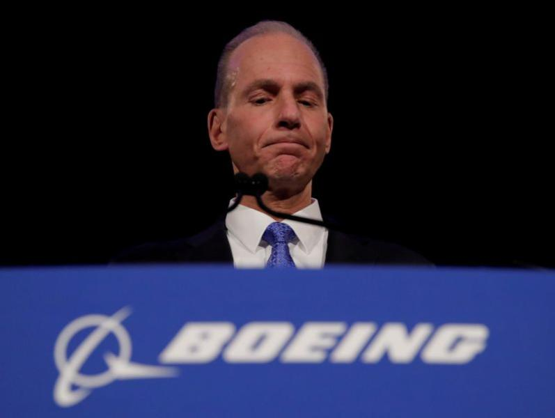FILE PHOTO: Boeing CEO Muilenburg pauses while speaking during a news conference at the annual shareholder meeting in Chicago