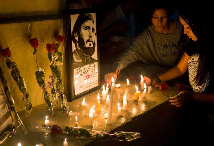 Students place candles around an image of the late Cuban leader Fidel Castro, at the university where Castro studied law as a young man, during a vigil in Havana, Cuba, Saturday, Nov. 26, 2016. (AP Photo/Ramon Espinosa)