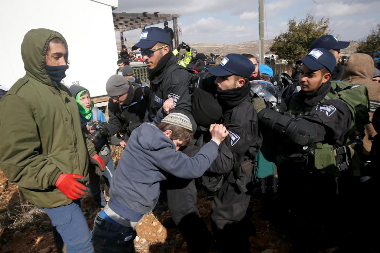 Pro-settlement activists scuffle with Israeli police.