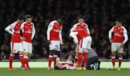 Britain Soccer Football - Arsenal v Leicester City - Premier League - Emirates Stadium - 26/4/17 Arsenal's Laurent Koscielny receives medical attention after sustaining an injury Reuters / Stefan Wermuth Livepic