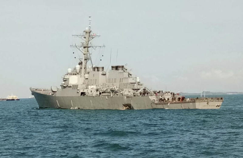 In this photo released by the Royal Malaysian Navy, the U.S guided-missile destroyer USS John S. McCain is seen after a collision, off Johor, Malaysia, Monday, Aug. 21, 2017. A number of U.S. sailors were missing after a collision between the USS John S. McCain and a tanker early Monday east of Singapore, the second accident involving a ship from the Navy's 7th Fleet in the Pacific in two months. (Royal Malaysian Navy via AP)