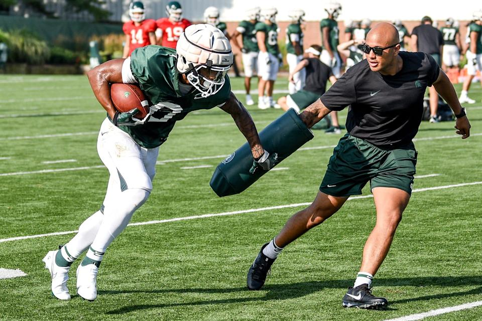 Michigan State's Keon Coleman runs after a catch during football camp on Tuesday, Aug. 17, 2021, on the MSU campus in East Lansing.