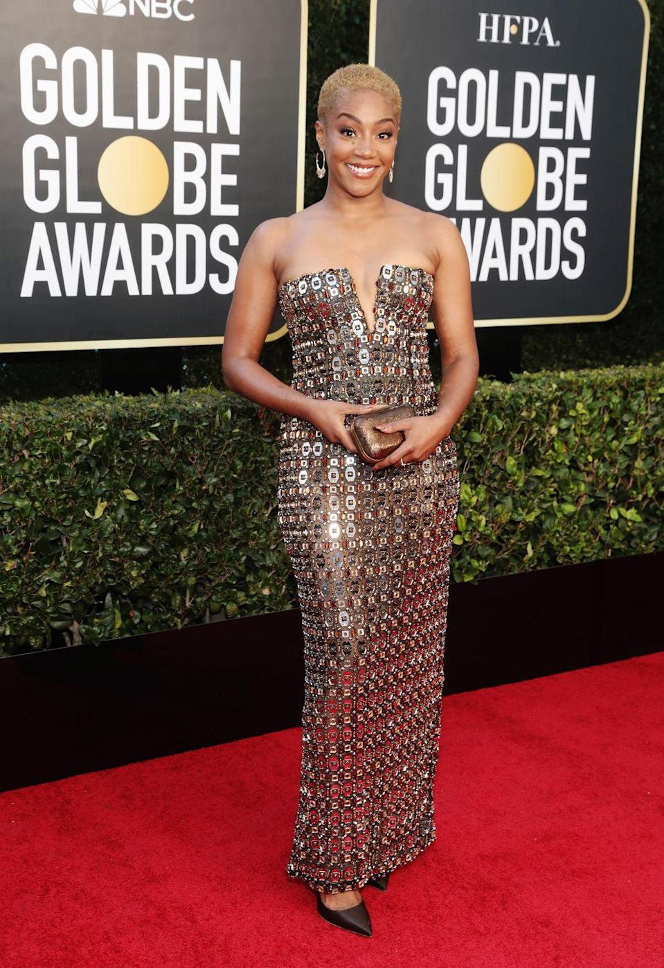 <p><strong>What: </strong>Alberta Ferretti </p><p><strong>Why:</strong> Haddish is bringing chainmail chicness in a custom strapless brown and silver embellished gown. It's somewhere between Pierre Cardin in the '60s and the knights of the round table and she looks fittingly strong and beautiful. </p>