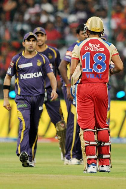 KKR skipper G Gambhir and RCB skipper Virat Kohli arguing during the IPL match between RCB v/s KKR at Chinnaswamy Stadium,in Bangalore on Thursday 11th April 2013
