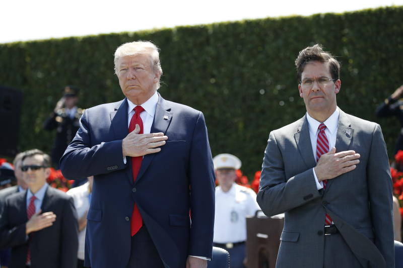 FILE - In this July 25, 2019, file photo, President Donald Trump and Secretary of Defense Mark Esper, right, stand during the playing of the National Anthem, during a ceremony for Esper, at the Pentagon. If there was one day that crystallized all the forces that led to the impeachment investigation of President Donald Trump, it was July 25. That was the day of his phone call with Ukraine's new leader, pressing him for a political favor.  (AP Photo/Alex Brandon, File)