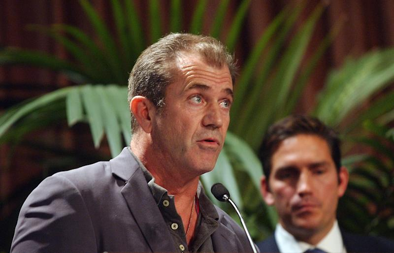 "Actor/Director Mel Gibson, left, talks about his film ""The Passion of the Christ"" as Jim Caviezel, left, who portrayed Jesus, looks on after Gibson accepted the Motion Picture Award during the Catholics in Media Awards ceremony, Sunday, Nov. 7, 2004, in Beverly Hills, Calif. Gibson and Caviezel were several people in the television and film industry who received awards from the Catholics in Media Associates, which recognizes people and projects that uplift and inspire. (AP Photo/Rene Macura)"