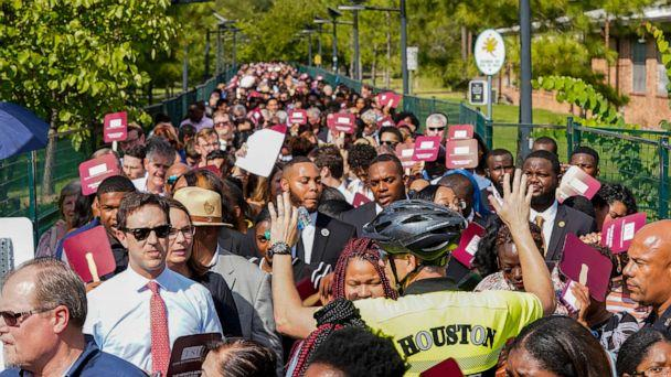 PHOTO: People wait to go through security before entering the Democratic presidential debate inside Texas Southern University's Health & PE Arena in Houston, Thursday, Sept. 12, 2019. (Elizabeth Conley/Houston Chronicle via AP)