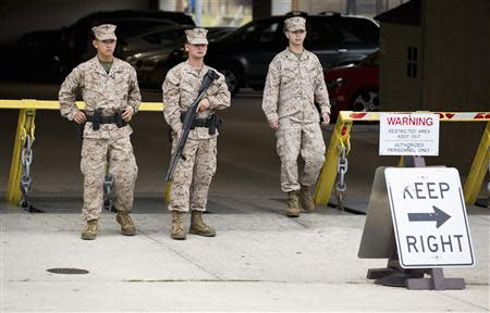 Members of the United States Marine Corps maintain a watch on their barracks as police respond to a shooting at the Washington Navy Yard