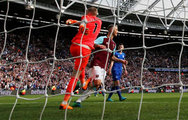 "Soccer Football - Premier League - West Ham United vs Everton - London Stadium, London, Britain - May 13, 2018 Everton's Jordan Pickford reacts after conceding a goal Action Images via Reuters/Paul Childs EDITORIAL USE ONLY. No use with unauthorized audio, video, data, fixture lists, club/league logos or ""live"" services. Online in-match use limited to 75 images, no video emulation. No use in betting, games or single club/league/player publications. Please contact your account representative for further details."