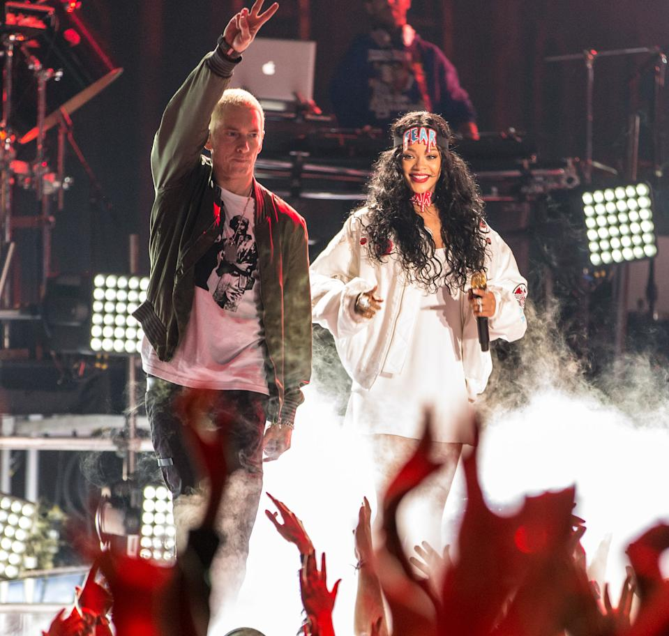 LOS ANGELES, CA - APRIL 13:  Recording artists Eminem (L) and Rihanna perform onstage at the 2014 MTV Movie Awards at Nokia Theatre L.A. Live on April 13, 2014 in Los Angeles, California.  (Photo by Christopher Polk/Getty Images for MTV)