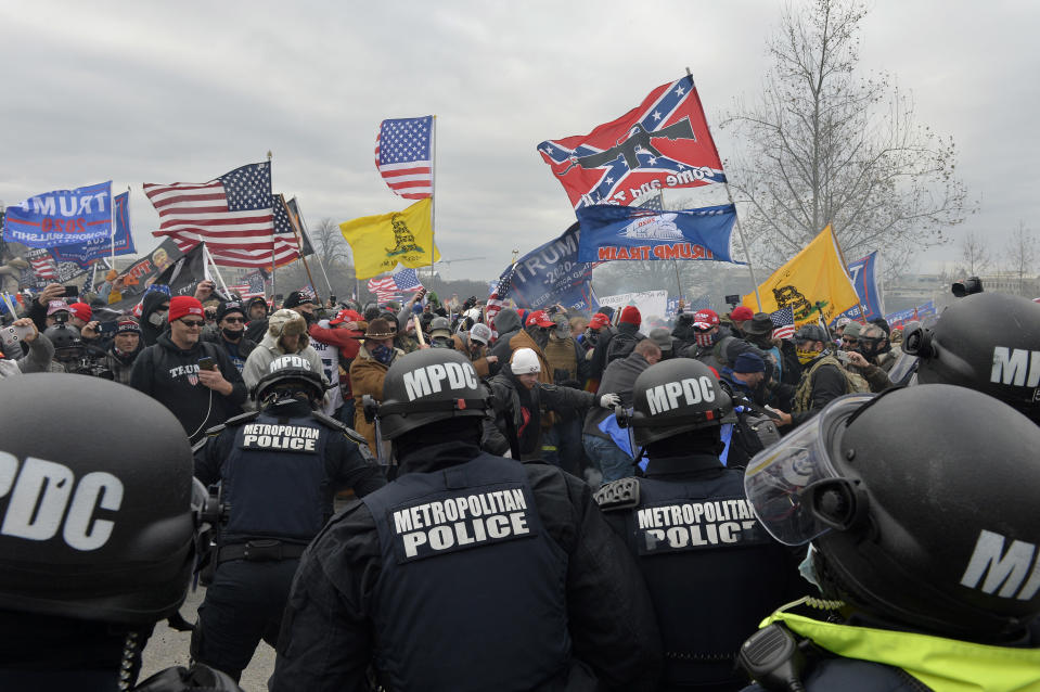 Trump supporters clash with police and security forces as they storm the US Capitol in Washington D.C on January 6, 2021. - Demonstrators breeched security and entered the Capitol as Congress debated the a 2020 presidential election Electoral Vote Certification. (Photo by JOSEPH PREZIOSO/AFP via Getty Images)