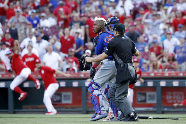 Reds right fielder Yasiel Puig was heated after Cubs reliever Pedro Strop hit him in the backside. (Photo by Joe Robbins/Getty Images)