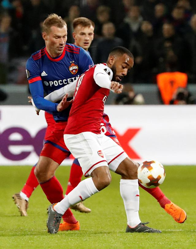 Soccer Football - Europa League Quarter Final Second Leg - CSKA Moscow v Arsenal - VEB Arena, Moscow, Russia - April 12, 2018 Arsenal's Alexandre Lacazette in action with CSKA Moscow's Aleksei Berezutski REUTERS/Grigory Dukor