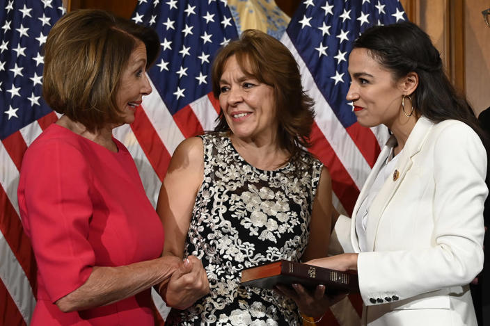 House Speaker Nancy Pelosi of Calif. (L) talks with Rep. Alexandria Ocasio-Cortez (D-N.Y.) (R), and her mother Blanca Ocasio-Cortez (C).