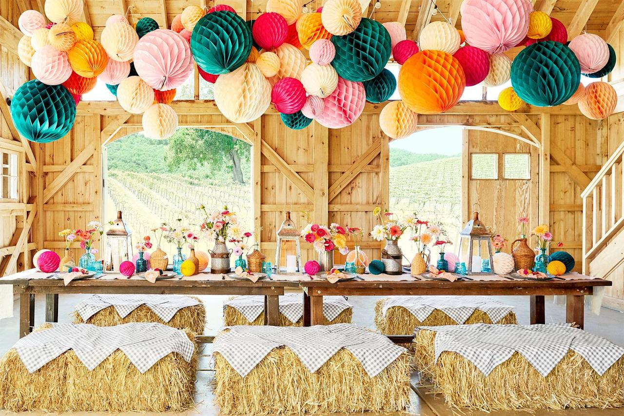 "<p>Orange and brown? For Thanksgiving? Definitely not groundbreaking. This year, include the rest of the rainbow, or at least add splashes of pink and green as done here. To keep it in line with the fall vibes, use bales of hang with gingham cloth covers as seats. </p><p><a class=""body-btn-link"" href=""https://www.amazon.com/FloraCraft-Straw-Bales-2-Inch-4-Inch-1-Inch/dp/B000XZW906/?tag=syn-yahoo-20&ascsubtag=%5Bartid%7C10057.g.2647%5Bsrc%7Cyahoo-us"" target=""_blank"">BUY NOW</a> <em><strong>Hay Bale, $7</strong></em></p>"
