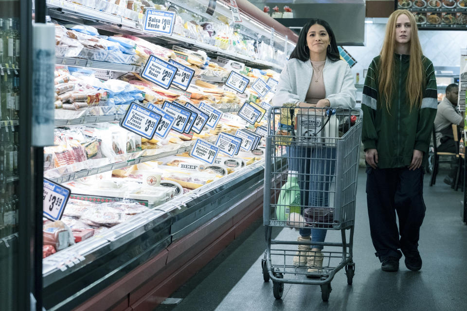 "This image released by Focus Features shows Gina Rodriguez , left, and Evan Rachel Wood in a scene from ""Kajillionaire."" (Matt Kennedy/Focus Features via AP)"