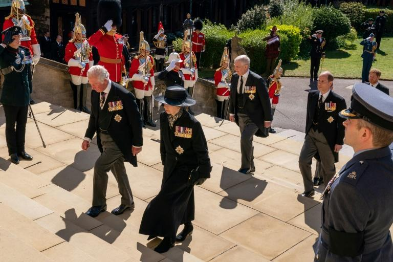 Britain's Prince Charles, Prince of Wales (L), Britain's Princess Anne, Princess Royal, (2L), Britain's Prince Andrew, Duke of York, (2R) and Britain's Prince Edward, Earl of Wessex, (R) follow the coffin into St George's Chapel