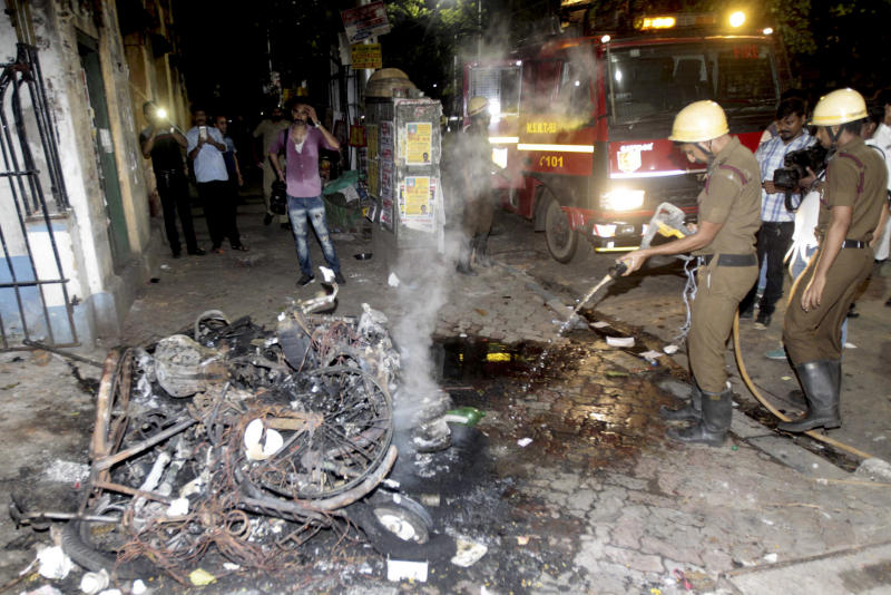 Firemen douse the fire after two wheelers were set on fire during clashes between Bharatiya Janata Party (BJP) workers and students outside the Calcutta University in Kolkata, India, Tuesday, May 14, 2019. Rival political supporters clashed with rocks and sticks during an election rally by the Hindu nationalist party BJP leaving several people injured and a university college vandalized. (AP Photo)