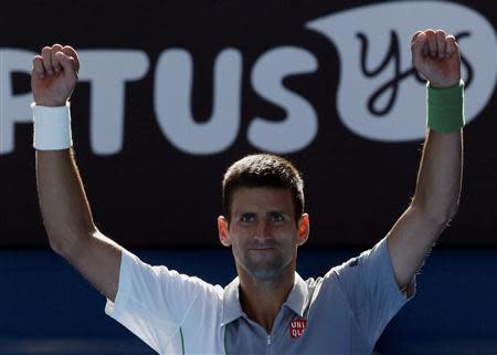 Novak Djokovic of Serbia celebrates defeating Fabio Fognini of Italy in their men's singles match at the Australian Open 2014 tennis tournament in Melbourne January 19, 2014. REUTERS/Jason Reed