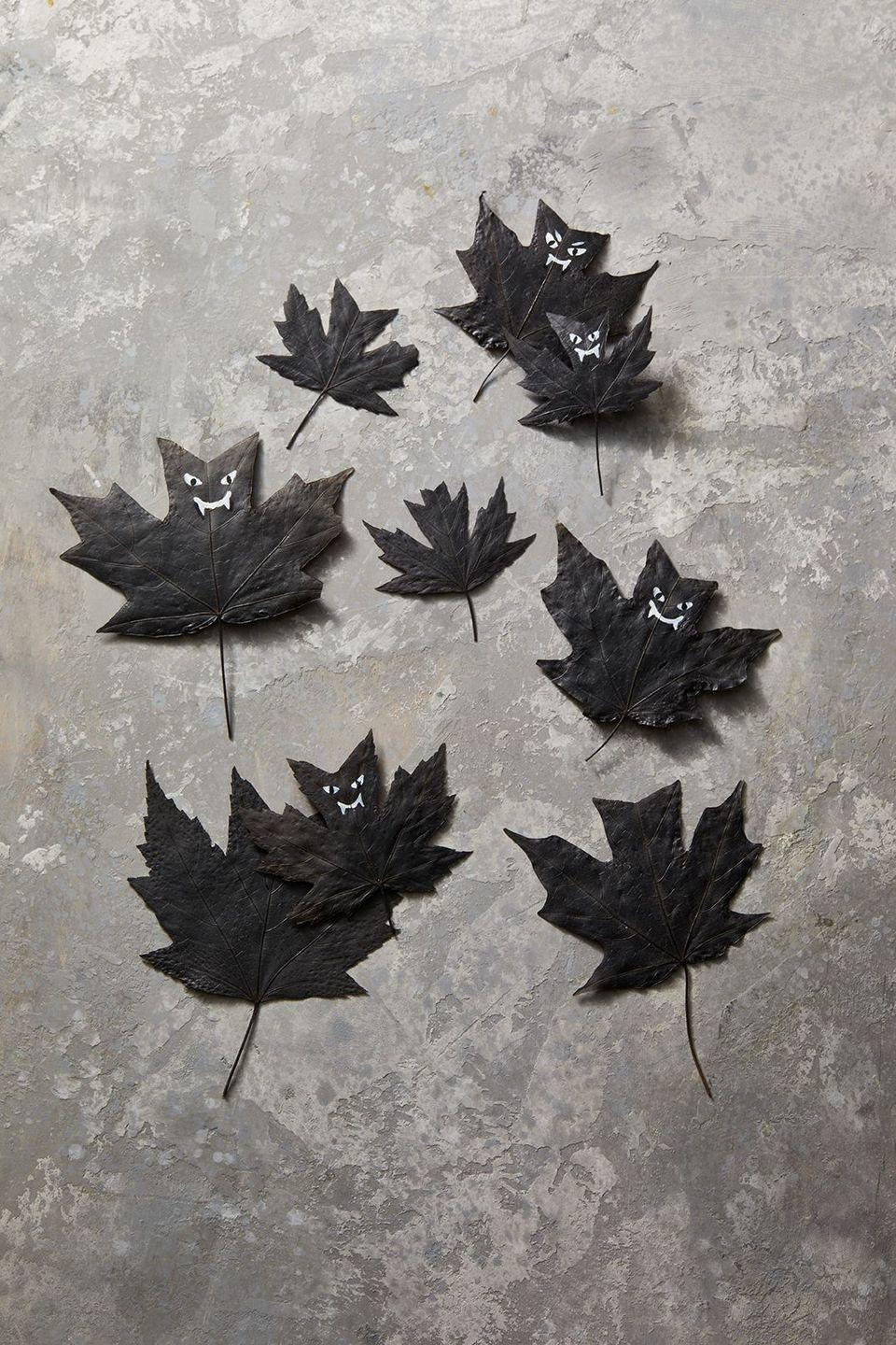 """<p>A great one for the kids to try! All you have to do is gather some leaves, spray them with matte black paint and use a white marker to draw on little faces.</p><p><a class=""""link rapid-noclick-resp"""" href=""""https://www.amazon.com/Krylon-K02754007-Fusion-Spray-Paint/dp/B07LFWTQJX/?tag=syn-yahoo-20&ascsubtag=%5Bartid%7C10055.g.421%5Bsrc%7Cyahoo-us"""" rel=""""nofollow noopener"""" target=""""_blank"""" data-ylk=""""slk:SHOP BLACK MATTE PAINT"""">SHOP BLACK MATTE PAINT</a></p>"""