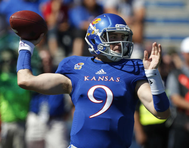 Kansas quarterback Jake Heaps (9) passes to a teammate during the first half of an NCAA college football game against Louisiana Tech in Lawrence, Kan., Saturday, Sept. 21, 2013. Kansas defeated Louisiana Tech 13-10. (AP Photo/Orlin Wagner)