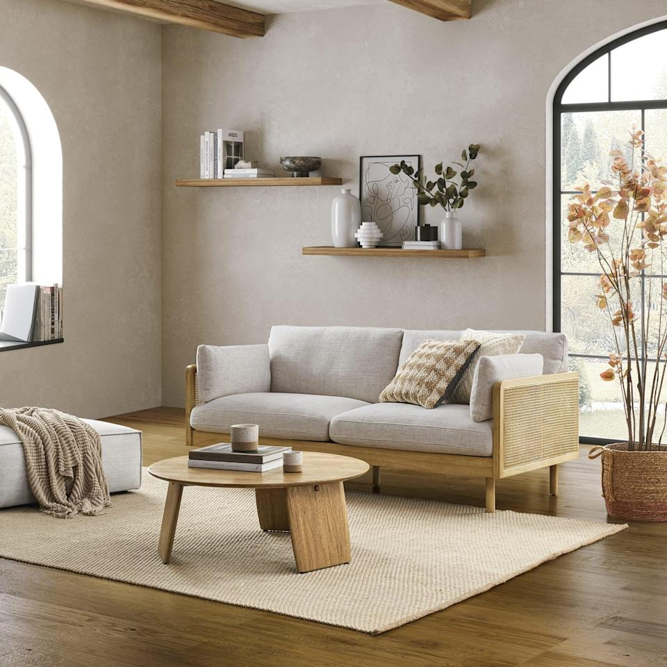 <p>The brand-new <span>Castlery Lucia Cane Sofa</span> ($1,399) is seriously chic and cozy. The plush cushions look like a dream, and I absolutely love the cane detailing.</p>