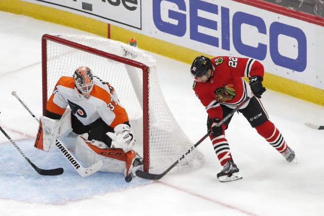Philadelphia Flyers goaltender Brian Elliott makes a save on a shot by Chicago Blackhawks' Ryan Carpenter during the second period of an NHL hockey game Thursday, Oct. 24, 2019, in Chicago. (AP Photo/Charles Rex Arbogast)