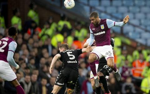 "Aston Villa joined Fulham and Cardiff in guaranteeing themselves at least a play-off place as the race for promotion to the Premier League moves closer to its denouement, although they reached their target by a somewhat nervous route in the end. Lewis Grabban's 17th goal of the season - his fifth in a Villa shirt - hardly provided an adequate reflection of Villa's dominance in the first half. They created plenty of chances in the second half but they ran into a determined opponent in Northern Ireland Under-21 goalkeeper Bailey Peacock-Farrell and the comfort of a second goal proved beyond them. Leeds have only won twice in their last 19 Championship matches but gave Villa some uncomfortable moments, early in each half in particular, and the one-goal lead looked tenuous at times. As it is, the second automatic promotion place alongside Wolves is still within Villa's reach and in Steve Bruce, promoted four times from the Championship with Birmingham City and Hull (twice each), they have a manager who knows what is required to get across the line. Lewis Grabban heads in the only goal of the game Credit: Getty images Bruce, who will be hoping Fulham and Cardiff take a tumble while he spends Saturday afternoon at Aintree, professed to have felt less nervous than some in the Villa crowd plainly did. His main concern was that too many of his players looked weary, the effort of beating high-flying Cardiff on Tuesday night catching up with a few of them. ""We gave the ball away too many times but that's what happens when you have tired players,"" he said. ""Five games in 13 days is a ridiculous schedule but that is what the Championship is. ""I still felt we were comfortable. I don't remember our keeper having to make too many saves."" He made one, in fact, in the third minute as Ezgjan Alioski, the Leeds wide player, tested Sam Johnstone with a shot he had to push over his bar. The Yorkshire side were largely on the back foot thereafter, however. Robert Snodgrass, facing the first of the five English clubs he has represented, drew a diving save from Peacock-Farrell, brought into the side last month after manager Paul Heckingbottom decided to take Felix Wiedwald out of the firing line, who was excellent throughout. When Villa scored in the 29th minute, they did look comfortable. Jack Grealish, unmarked as he retrieved the ball wide on the left, stepped past his marker and crossed towards the edge of the six-yard box, where Grabban climbed above Matthew Pennington to head into the corner of the net. Villa's confidence looked high and they should have been further ahead. Jonathan Kodjia, starting his first match since late October following an ankle injury, saw plenty of the ball and might have made more of it had he been sharper. Leeds began the second half with much more purpose, though, and there was a reminder for Villa that a one-goal lead was nothing to feel complacent about as a shot whipped in by Kalvin Phillips beat Johnstone and was headed away in front of his left-hand post by Glenn Whelan, although replays suggested the ball was going wide. The visitors looked increasingly threatening, Villa increasingly nervous, yet another chance for the home side to give themselves breathing space came and went as Peacock-Farrell defied Grabban and Kodjia in quick succession. Fortunately for them, Leeds, who have not won away from home this year, faded in the closing stages in the way Bruce will hope his pick in the Grand National field does not."