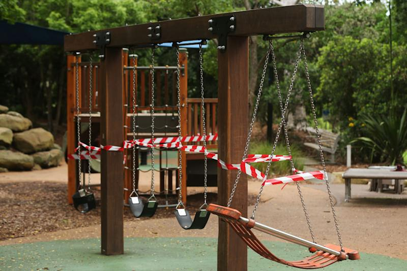 Hazard tape is seen on outdoor playground equipment at Hallstrom Park, Willoughby in Sydney.