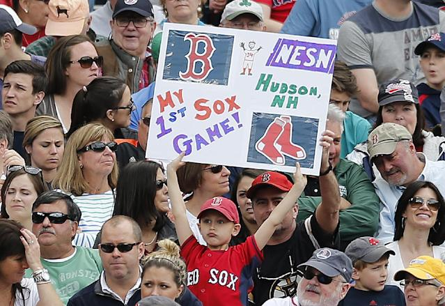 A young fan holds a sign in the fifth inning of a baseball game between the Boston Red Sox and the Oakland Athletics in Boston, Saturday, May 3, 2014. (AP Photo/Michael Dwyer)