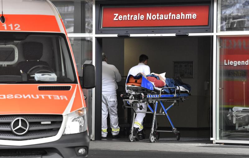 In this Tuesday, Feb. 12, 2019 photo, a patient is taken to the emergency room of the University Medical Center in Duesseldorf. The German hospital placed advertisements in Polish newspapers in the UK to hire Polish nurses who may leave the United Kingdom because of the Brexit. (AP Photo/Martin Meissner)