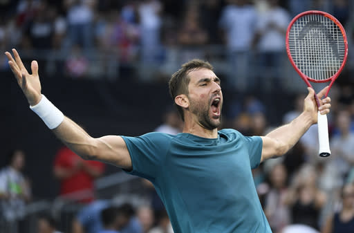 Croatia's Marin Cilic celebrates after defeating Spain's Roberto Bautista Agut in their third round singles match at the Australian Open tennis championship in Melbourne, Australia, Friday, Jan. 24, 2020. (AP Photo/Andy Brownbill)