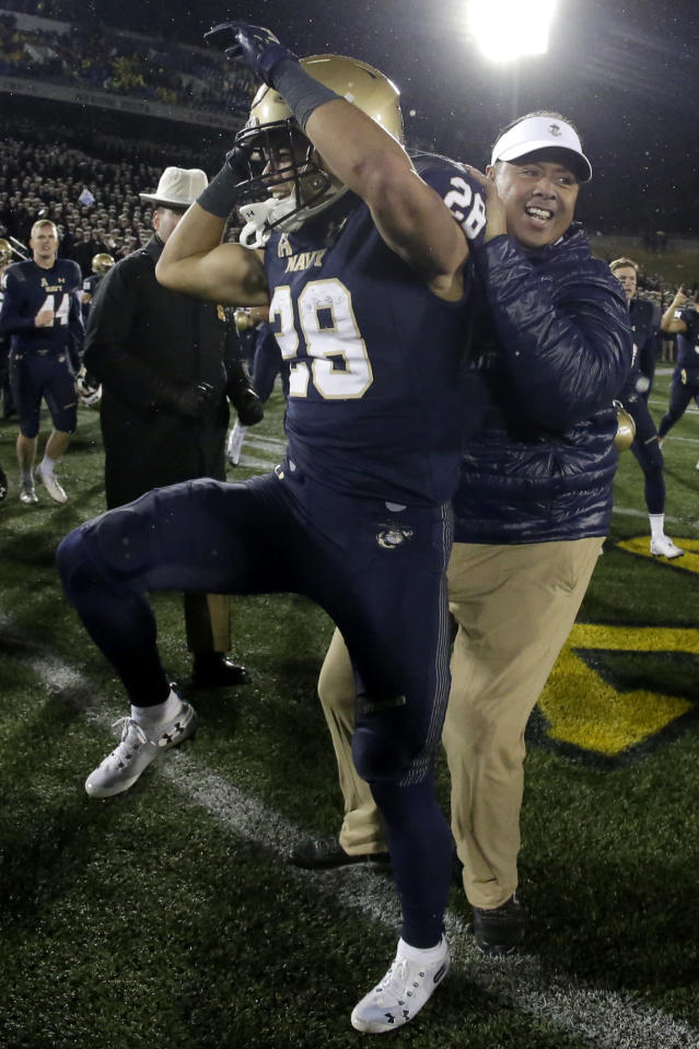 Navy head coach Ken Niumatalolo, right, celebrates with linebacker Dakare Coston after defeating SMU during an NCAA college football game, Saturday, Nov. 23, 2019, in Annapolis, Md. Navy won 35-28. (AP Photo/Julio Cortez)