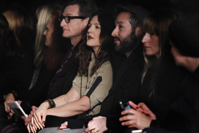 Actress Drew Barrymore (C) watches a presentation of the Rag & Bone Autumn/Winter 2013 collection during New York Fashion Week, February 8, 2013. REUTERS/Lucas Jackson (UNITED STATES - Tags: FASHION ENTERTAINMENT) - RTR3DIR5