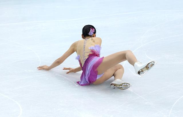 SOCHI, RUSSIA - FEBRUARY 08: Mao Asada of Japan falls while competing in the Figure Skating Team Ladies Short Program during day one of the Sochi 2014 Winter Olympics at Iceberg Skating Palace on February 8, 2014 in Sochi, Russia. (Photo by Matthew Stockman/Getty Images)