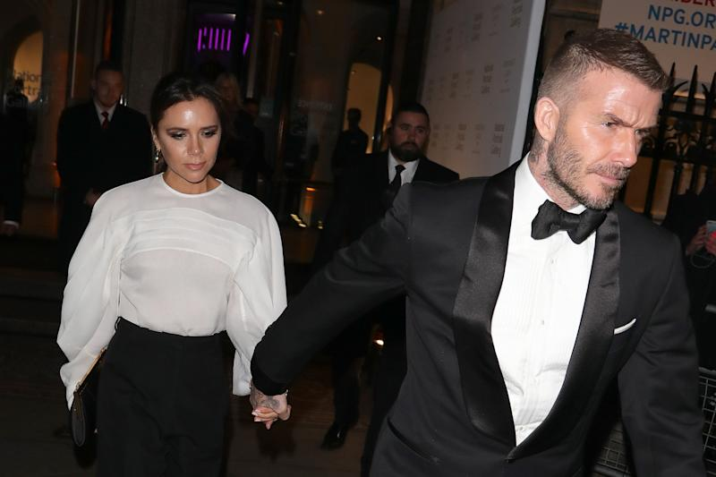 LONDON, ENGLAND - MARCH 12: David Beckham and Victoria Beckham leaving the National Portrait Gallery gala on March 12, 2019 in London, England. (Photo by Mark R. Milan/GC Images)