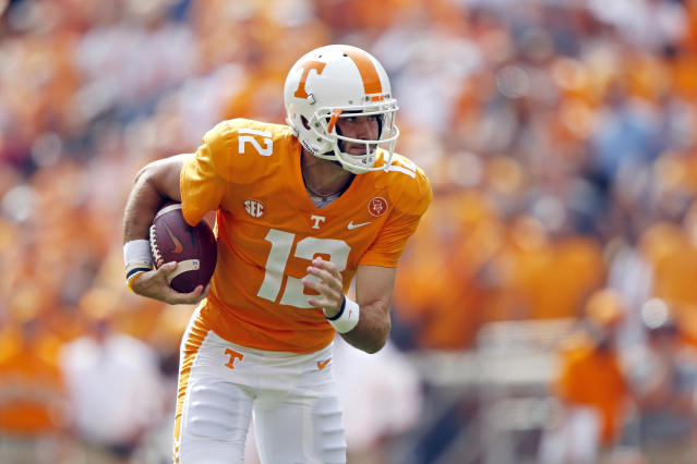 "Tennessee quarterback <a class=""link rapid-noclick-resp"" href=""/ncaaf/players/251721/"" data-ylk=""slk:Quinten Dormady"">Quinten Dormady</a> (12) is seen in the first half of an NCAA college football game against South Carolina Saturday, Oct. 14, 2017, in Knoxville, Tenn. (AP Photo/Wade Payne)"