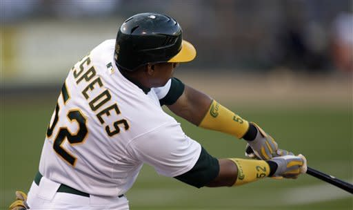 Oakland Athletics' Yoenis Cespedes swings for a two-run home run off New York Yankees' Freddy Garcia in the first inning of a baseball game on Thursday, July 19, 2012, in Oakland, Calif. (AP Photo/Ben Margot)